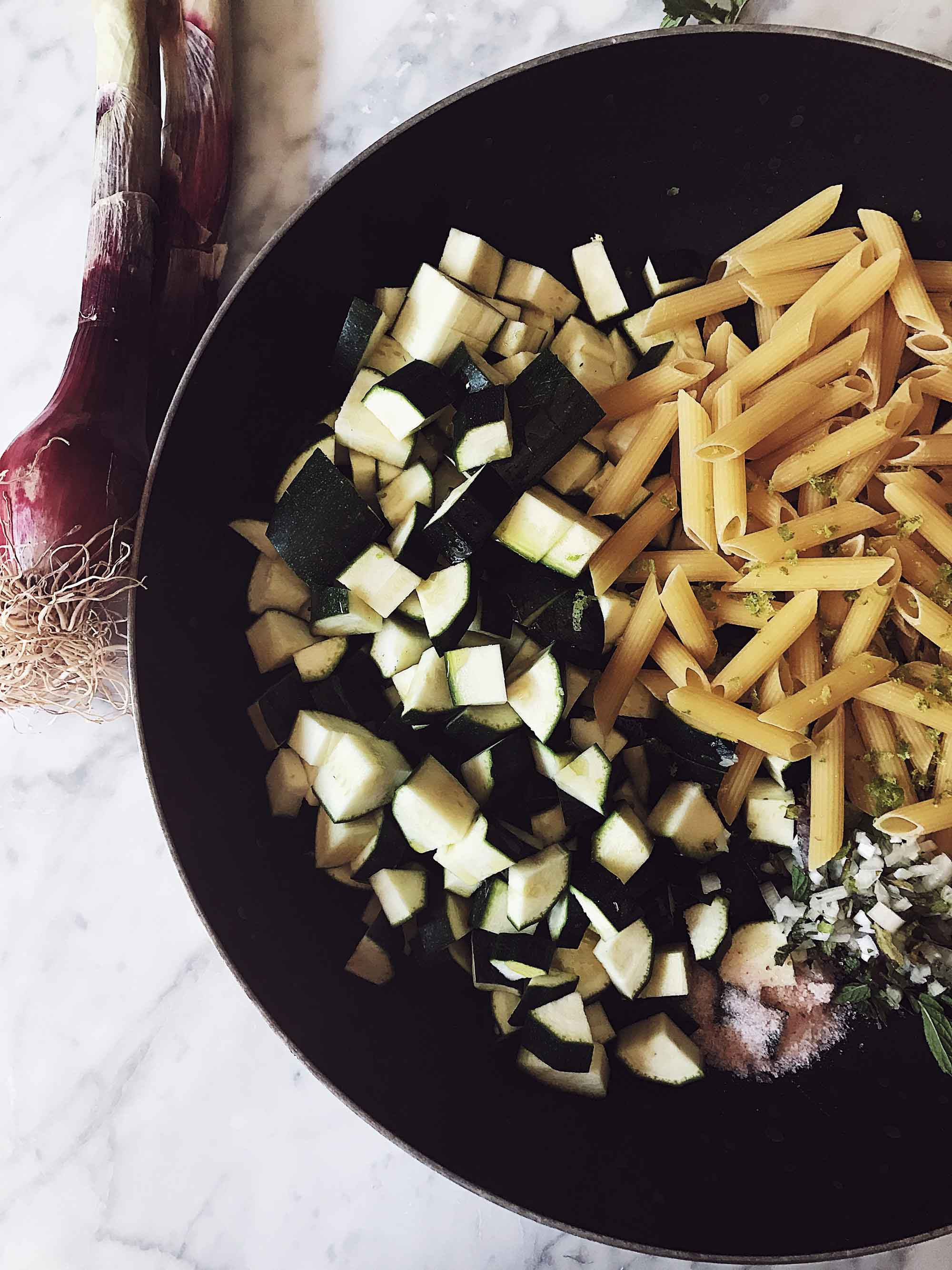 zucchini one pot pasta ingredients in a large pan