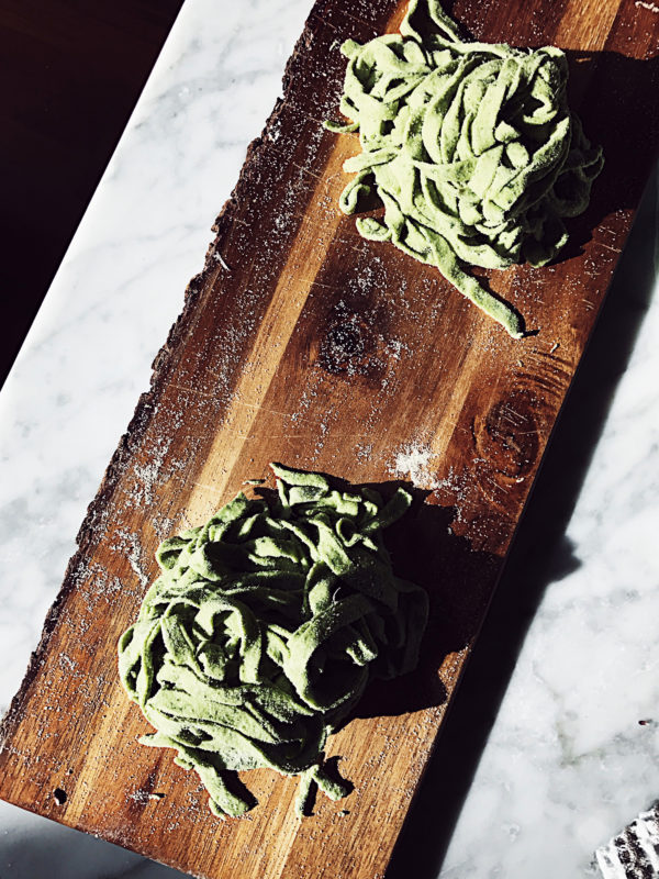 An easy basil homemade pasta dough recipe, by hand or with the pasta machine.
