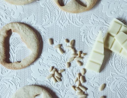 Italian christmas cookies: pine nuts, mascarpone and white chocolate icing