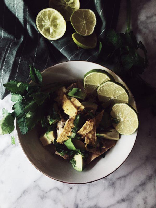 A tortilla soup recipe in a wintry, orang-y version: hot broth, fresh avocado and crispy tortilla fries.