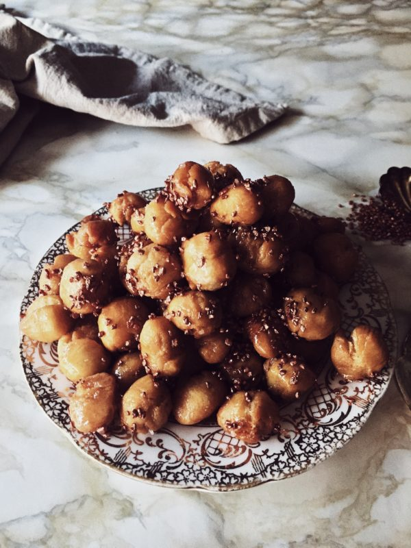 the italian struffoli recipe: tiny dough balls, fried and dipped in honey, lastly sprinkled with colorful confetti