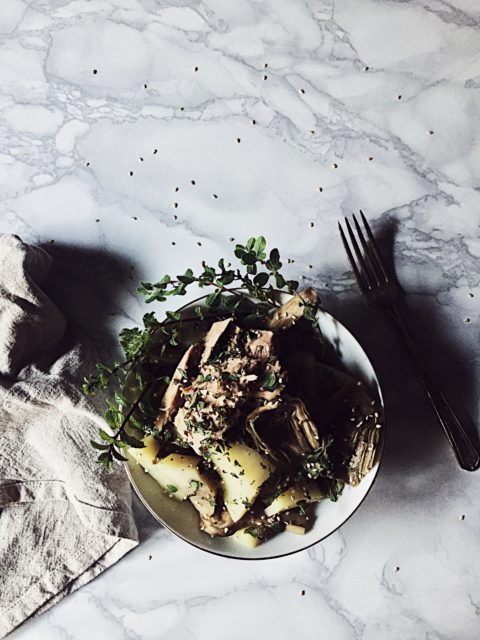 an Italian tuna salad recipe with steamed artichokes and potatoes, fresh oregano and mint, and sesame seeds