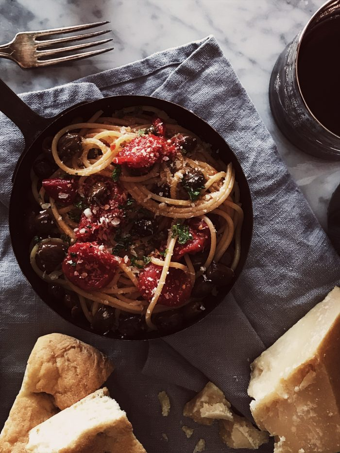 The traditional pasta puttanesca recipe a tomato sauce with olives, capers and anchovies. Plus, the origins of the puttanesca sauce.