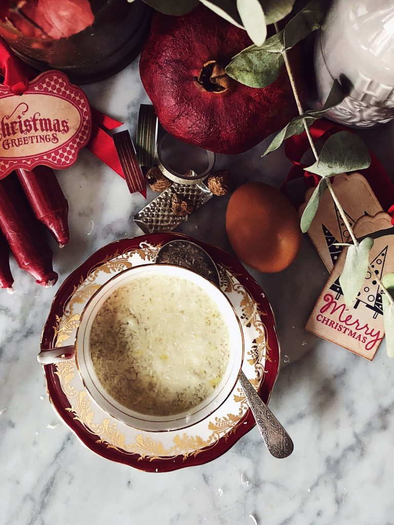 stracciatella soup served in a vintage red and gold china cup