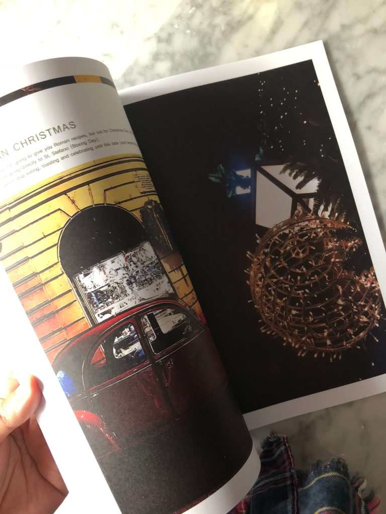 a red car and Christmas street lights in a page of the Gourmet Mag