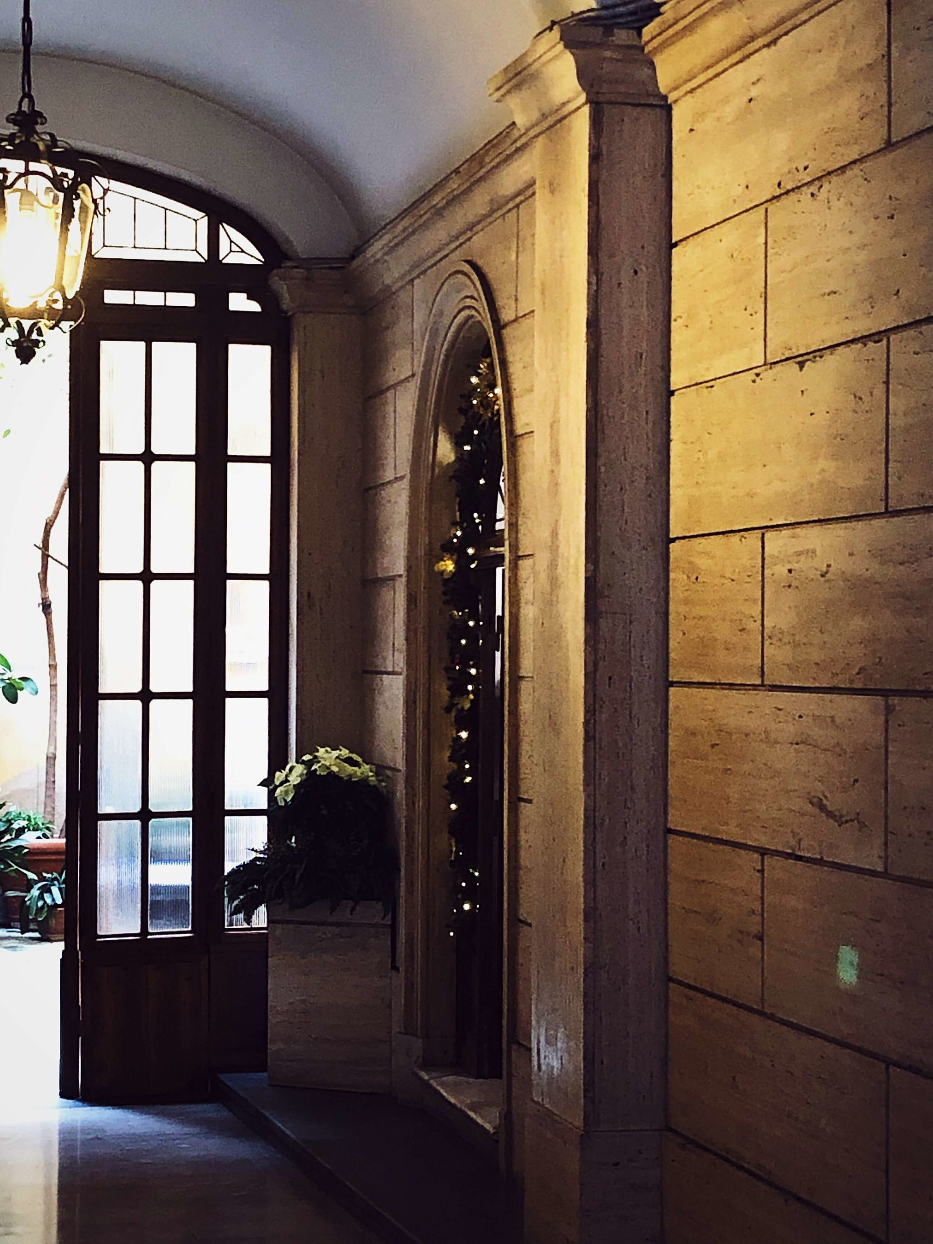 Roman palazzo entrance decorated for Christmas