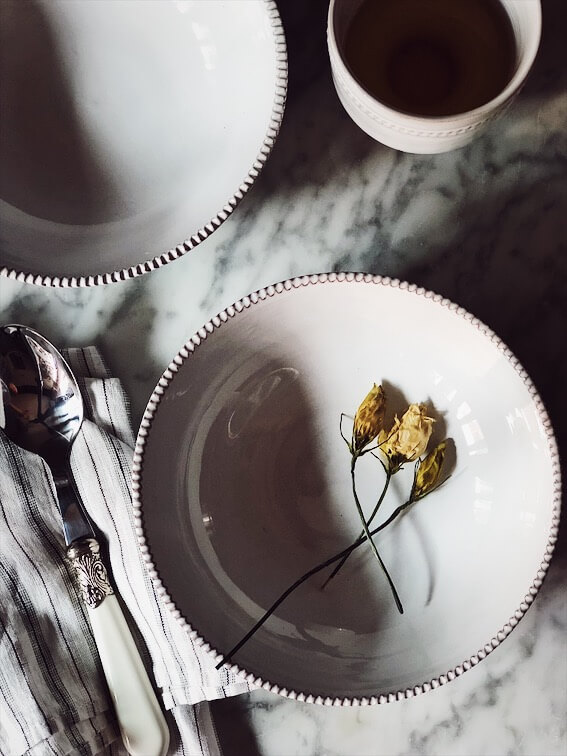 minestrone soup recipe-empty bowl with dried flowers