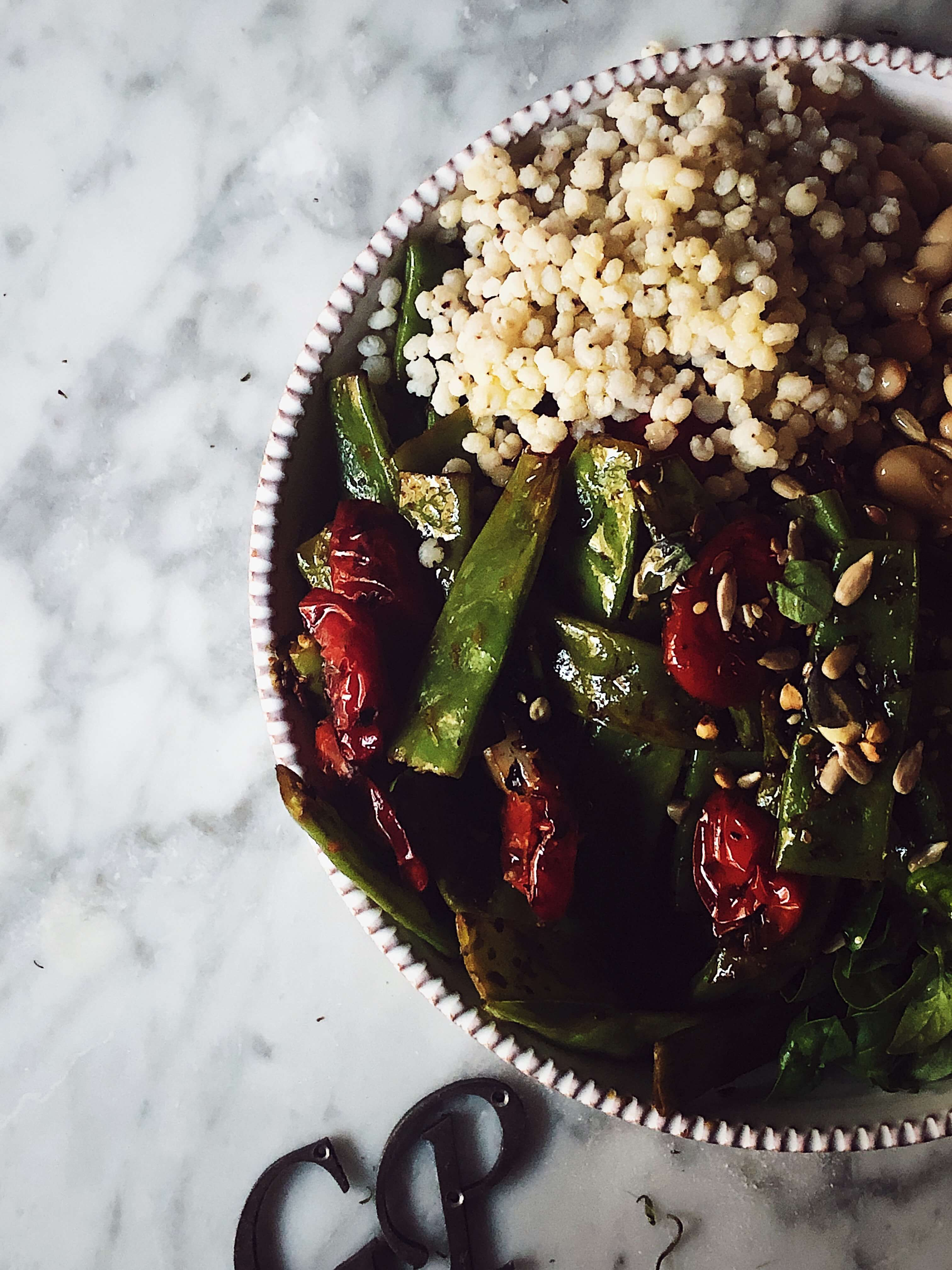 buddha bowl with farro sugar snaps tomatoes and beans
