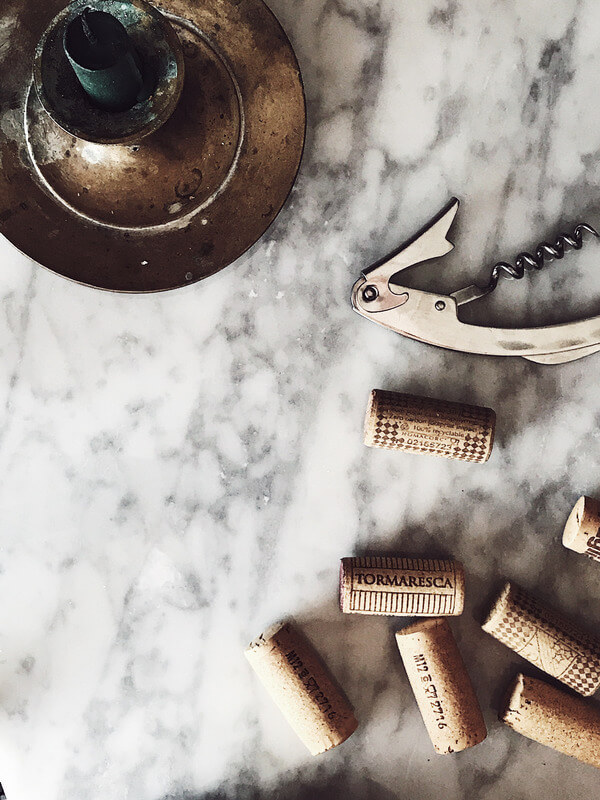 food magazine pic of candle bottle opener and corks