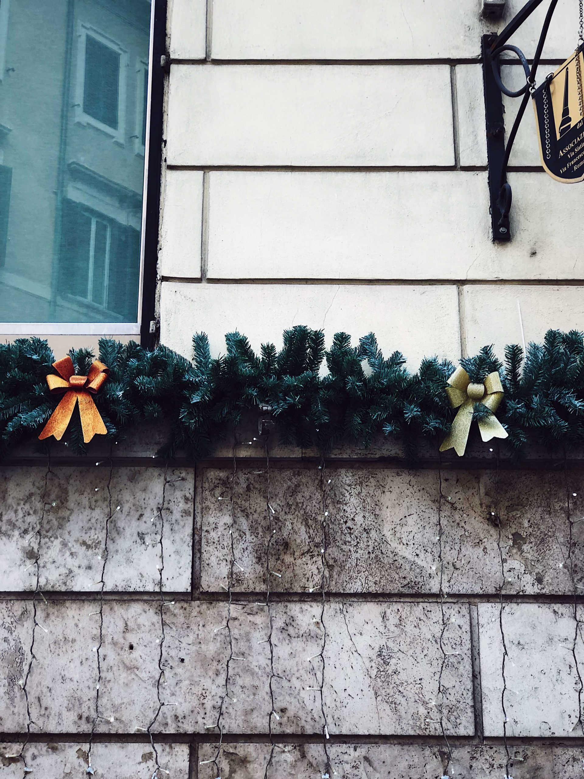 Christmas street decorations in Rome made with bows
