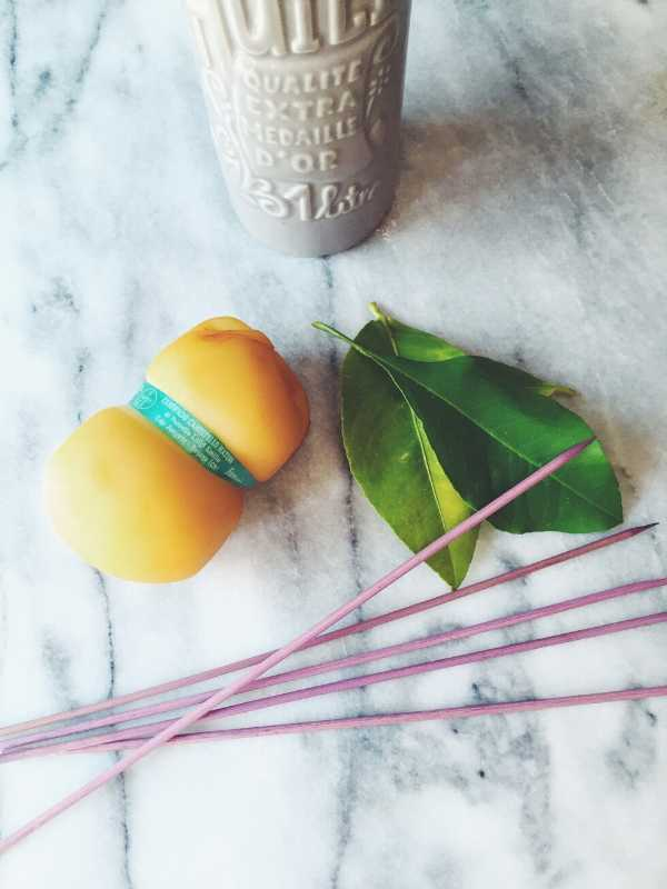 scamorza cheese, skewers, and lemon leaves