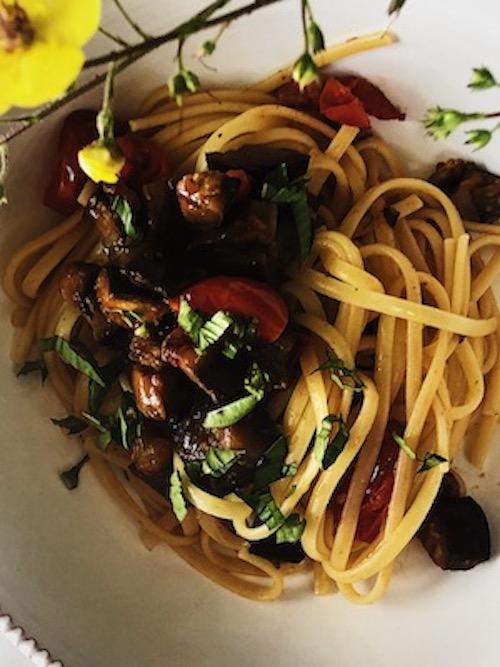 smashed garlic clove for the Italian eggplant pasta sauce recipe